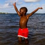 Outdoor Afros Swim in Open Water for a Good Cause